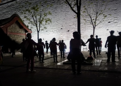 Evening line dancing exercise just outside Xi'an City Wall
